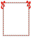Christmas candycane frame candy cane with festive red bows Stock Images