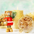 Christmas card background with gold candle and decorative bear Stock Images