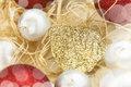 Christmas card with balls and gold leaf Stock Images