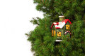 Christmas card with ceramic house colourful on tree on white background Stock Images