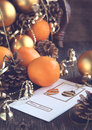 Christmas card with christmas decoration oranges and pine cones toned image Royalty Free Stock Images