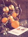 Christmas Card with Christmas decoration, oranges and pine cones Royalty Free Stock Photo