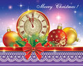 Christmas card with a clock balls on background of the Stock Images