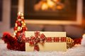 Christmas card and decoration by fireplace on floor cosy selective focus Stock Photos