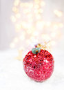 Christmas card with festive glowing decorations and christmas li lights copy space for greeting text twinkling red apple bauble Stock Image