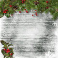 Christmas card fir branches and holly on a wooden background vintage with pine cones frosty for congratulations albums Stock Photos