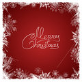 Christmas card with frame of snowflakes on a red background Royalty Free Stock Image