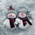 Christmas card. funny snowmen . Royalty Free Stock Photo