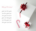 Christmas card with gift white boxes and candycane on white background Royalty Free Stock Photo
