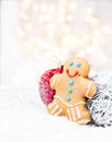 Christmas card with gingerbread man cookie festive decorations and lights copy space for greeting text twinkling Royalty Free Stock Images