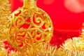 Christmas card golden bauble and tinsel Royalty Free Stock Photos