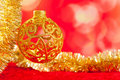 Christmas card golden bauble and tinsel Stock Photography