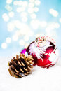 Christmas card with handmade bauble and cone with festive decora decorations lights twinkling ball on white snow Royalty Free Stock Photos