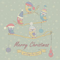 Christmas card and happy new year greeting with cute owls in winter caps sitting on branches cartoon style Stock Photo