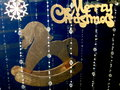 Christmas card with horse stock photos golden on blue background Royalty Free Stock Photos
