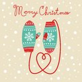 Christmas card with mittens knitted Royalty Free Stock Image