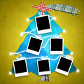 Christmas card with six empty frames for photos hanging on a fir Royalty Free Stock Images