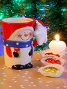 Christmas card snowman and candle stock photos red mug chocolates on xmas tree background Stock Images