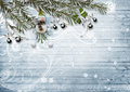 Christmas card. With snowy fir branches, berries and a snowman o Royalty Free Stock Photo