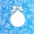 Christmas card stylized bauble cut in blue paper with hand drawn snowflakes background Royalty Free Stock Photography