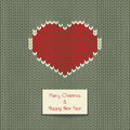 Christmas card vector knitted with heart and text Stock Image