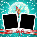 Christmas cards photo frames cute elf two instant and within a ball on blue paper background Stock Photo
