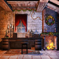 Christmas castle room with a fireplace candles and decorations Royalty Free Stock Images