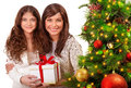 Christmas celebration at home young mother with daughter having fun near beautiful decorated xmas tree receive present happy Stock Photography