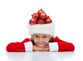 Christmas celebration and preparation concept with little santa wearing a hat full of baubles Stock Images
