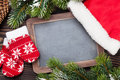 Christmas chalkboard, decor and fir tree Royalty Free Stock Photo