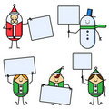 Christmas characters holding signs Royalty Free Stock Photography