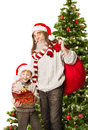 Christmas child presents santa claus grandfather holding bag and with red in front fir tree Royalty Free Stock Photo