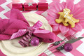 Christmas children family party table place settings in pink and white theme Royalty Free Stock Photo