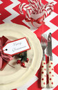 Christmas children family party table place settings in red and white theme Royalty Free Stock Photo