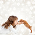 Christmas children girl hug a puppy brown dog Stock Images