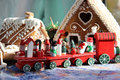 Christmas for children with toy red train bear and snowman and wreath Stock Photos