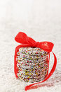 Christmas chocolate sprinkle and red ribbon Stock Photo