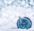 Christmas. Christmas blue balls and silver ribbon snow and space abstract background. Royalty Free Stock Photo
