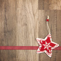 Christmas christmas ornament decoration with wood background star red with ribbon Stock Images