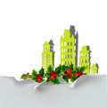 Christmas city background with holly made of paper stickers Royalty Free Stock Photo