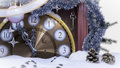Christmas clock,key and fir branches covered with snow concept background Royalty Free Stock Photo