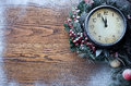 Christmas clock over snow wooden background five to twelve Stock Photos