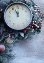 Christmas clock over snow wooden background five to twelve Stock Photography