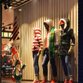 Christmas clothing window,Winter fashion boutique display window with mannequins Royalty Free Stock Photo