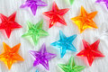 Christmas colorful glass stars over white fur Royalty Free Stock Photo