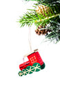 Christmas colorful small train on fir branches with snow decor wooden decorations isolated white background Stock Photos