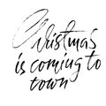 Christmas is coming to town. Handdrawn white and black modern dry brush lettering. Vector illustration.