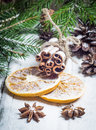 Christmas composition with anise stars, pine cones and dried orange