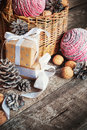 Christmas composition with box basket pine cones and walnuts close up Stock Images