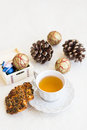 Christmas composition with cup of tea cookies and bumps balls Stock Image